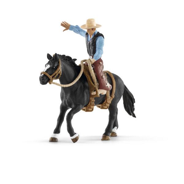 Monta de bronco con vaquero
